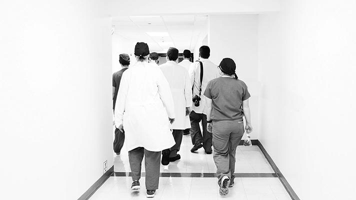 Medical staff walking down a hallway