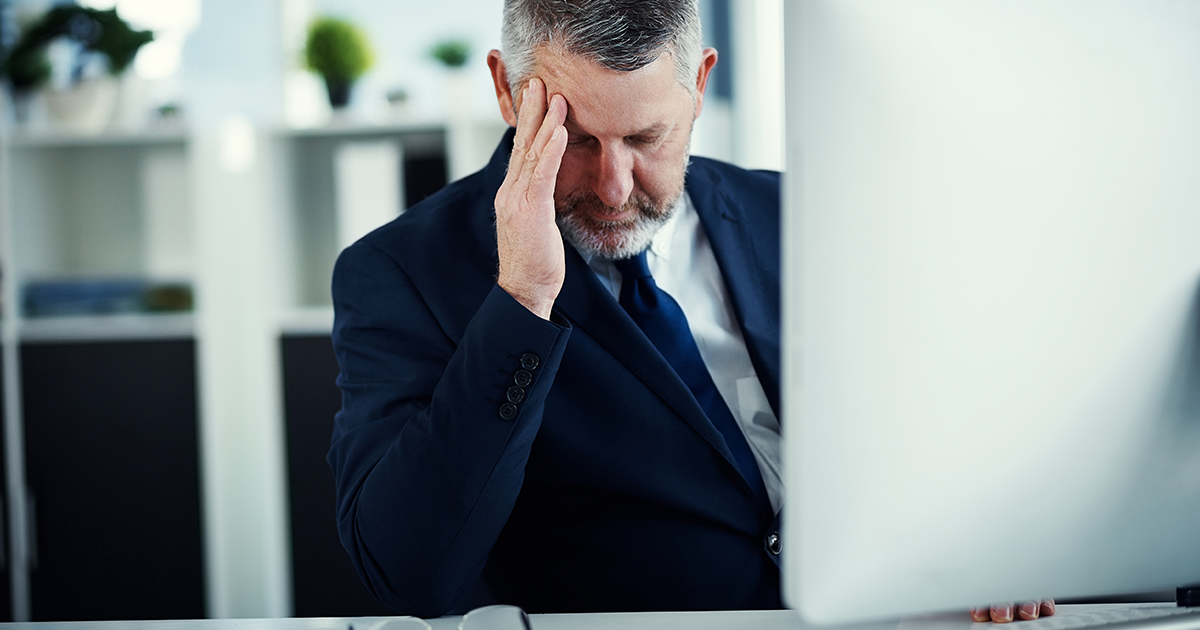 CIO experiences burnout, places hand to forehead