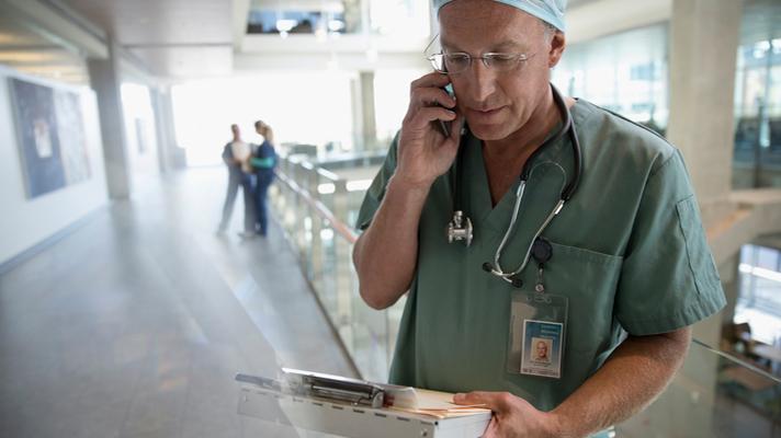 Doctor using smartphone.