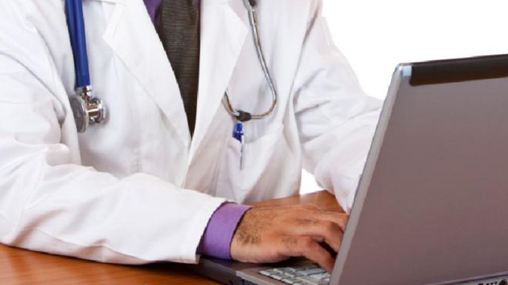Doctor at computer.