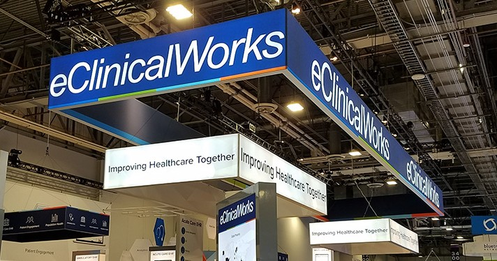 eClinicalWorks logo at a trade show booth