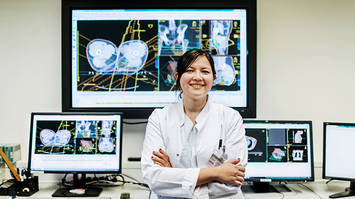 Woman with health imaging screens.