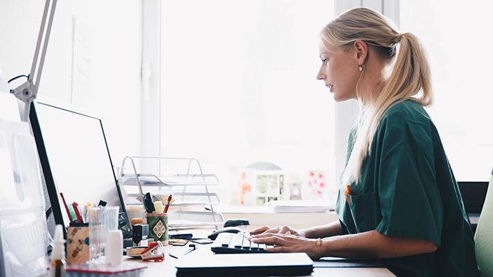 A nurse sitting at a computer
