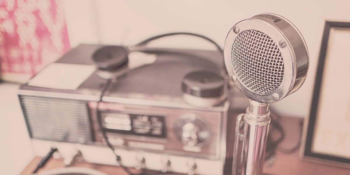 An old-timey microphone and radio setup represents our weekly digital health podcast