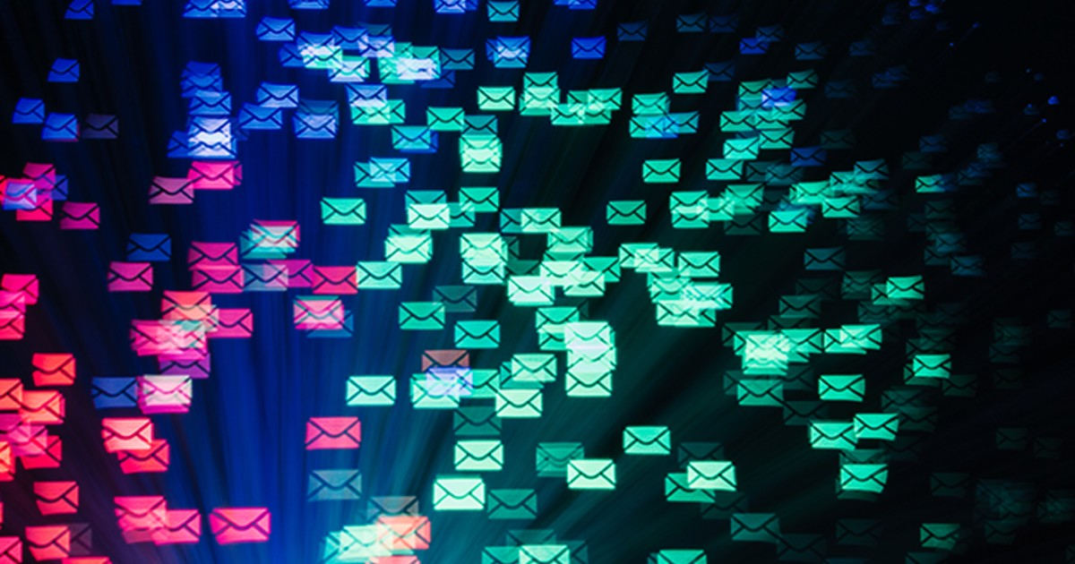 Email icons flying through a dark background