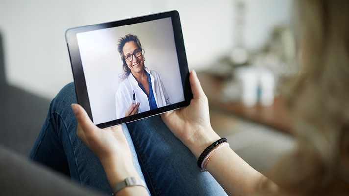 Woman attending telehealth appointment