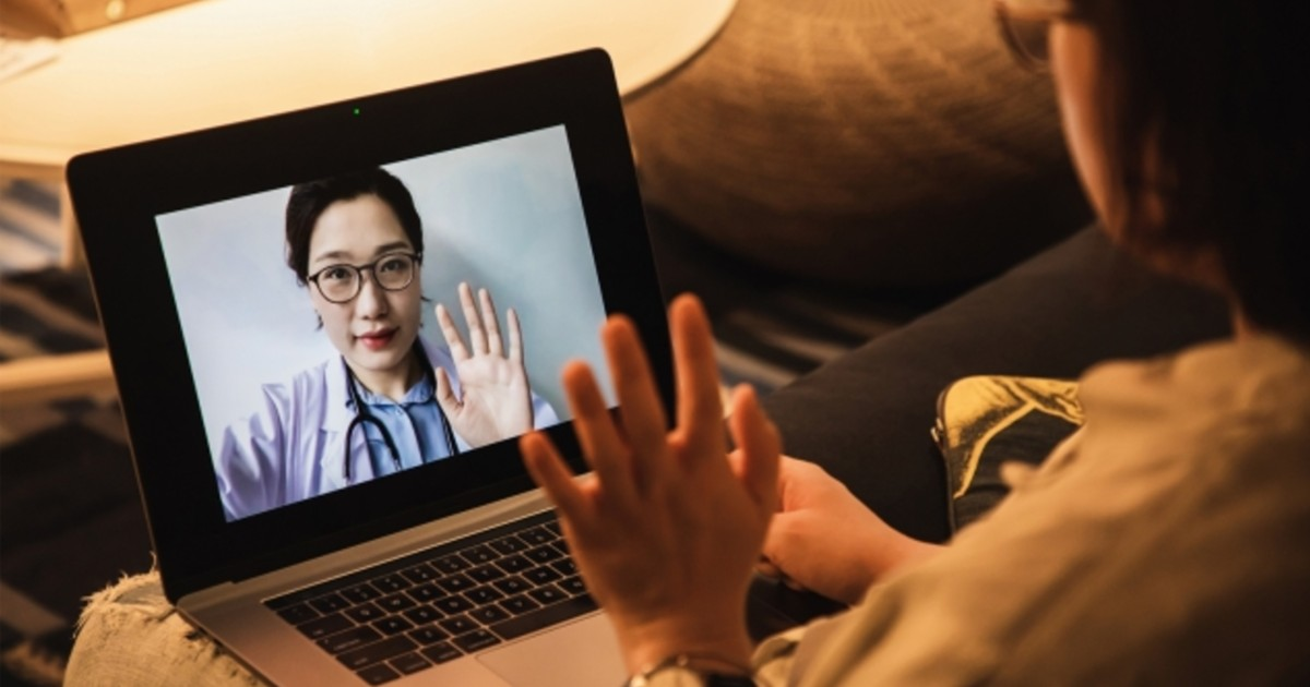 A telehealth consultation taking place on a tablet