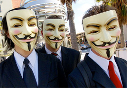 Anonymous group wearing Guy Fawkes masks, photo by Vincent Diamante