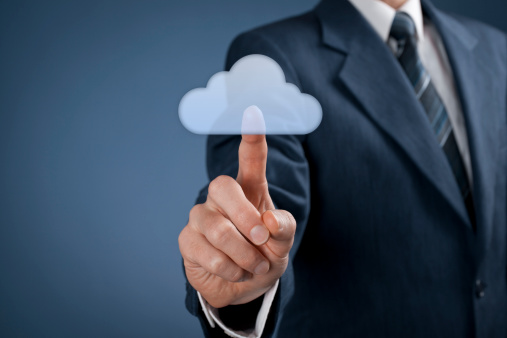 Man pushing cloud computing button