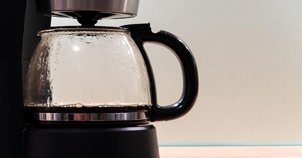 A coffee pot in a machine