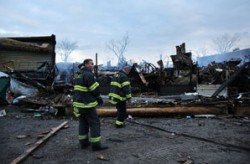 "a:2:{s:5:""title"";s:145:""Firefighters stand among the remains of buildings consumed by fire in Queens, N.Y., during Hurricane Sandy (Photo by Spencer Platt/Getty Images)."";s:3:""alt"";s:0:"""";}"