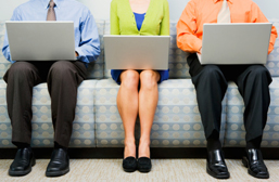Men and woman with laptops