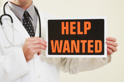 doc holding help wanted sign
