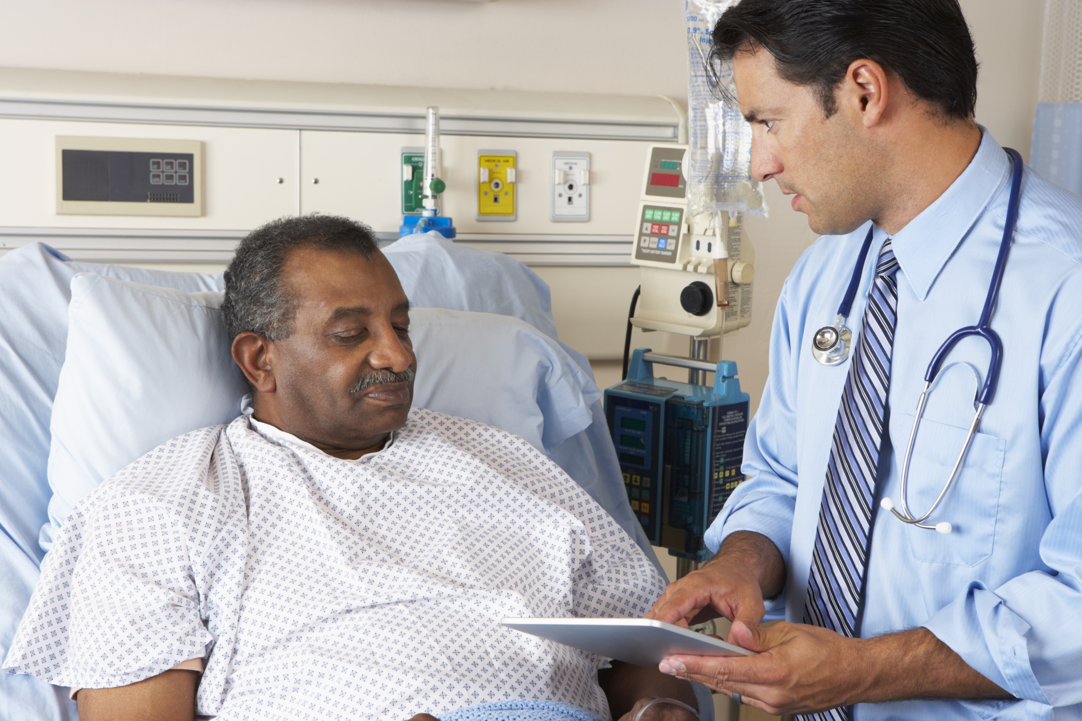 doctor and patient on tablet EHR