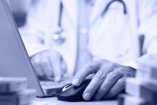 Doc using laptop