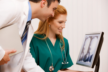 Doctors with images on laptop