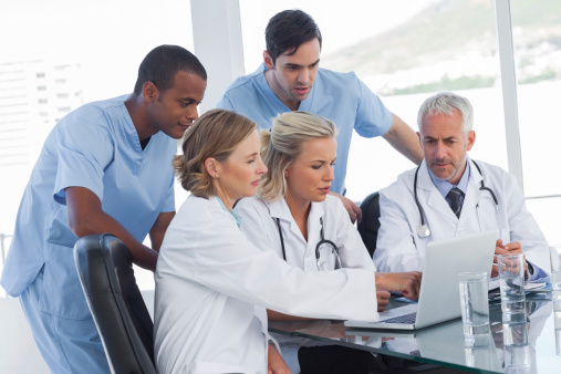 Doctors with laptop