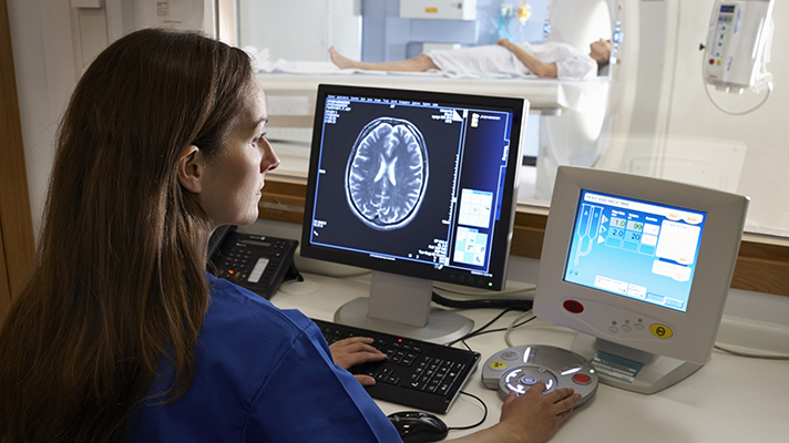 doctor reviewing CT scan security flaws