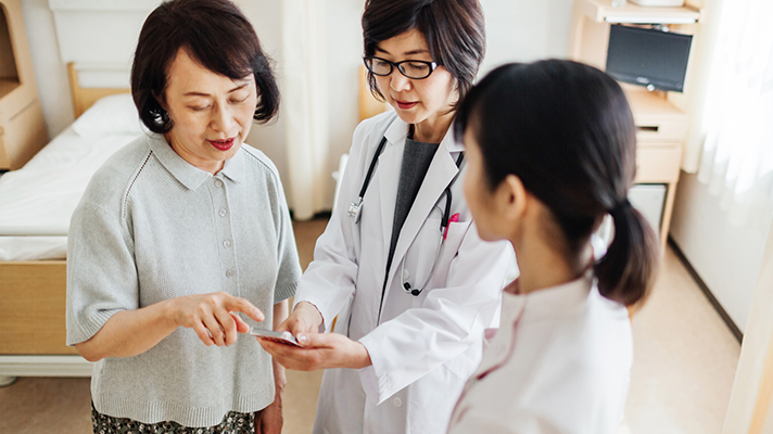 doctors using technology with patients