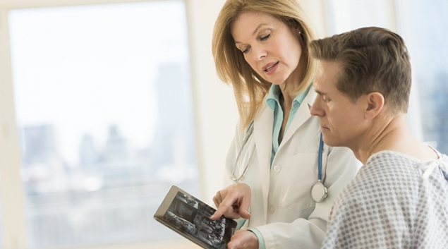 Doctor with patient EHR