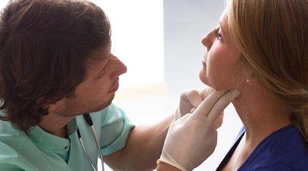 Doctor examining patient.