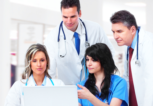 doctors looking at computer