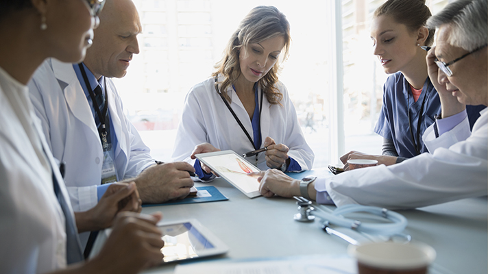 doctors collaborate in boardroom