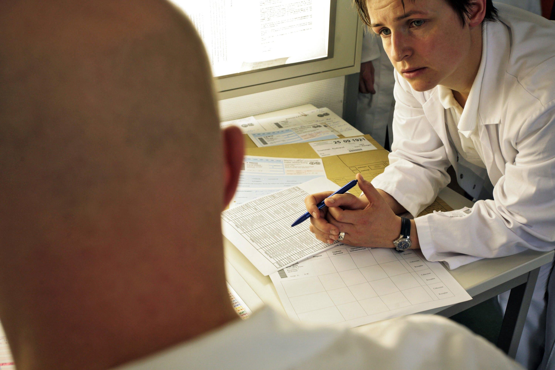 doctors talking over paperwork