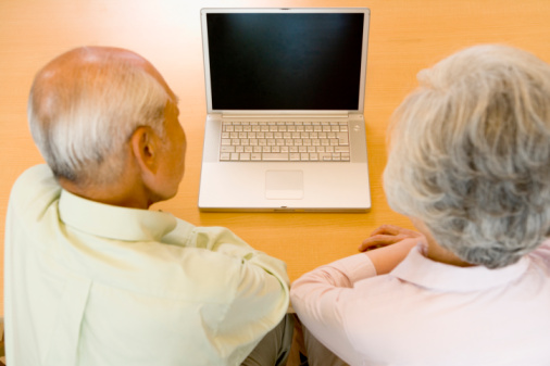 Elderly couple and laptop