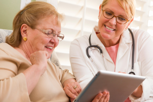 Elderly patient and doc with tablet