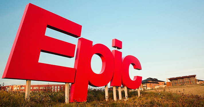 Epic logo sign in field before brick buildings