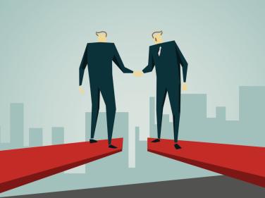 Illustration of businessmen standing over gap