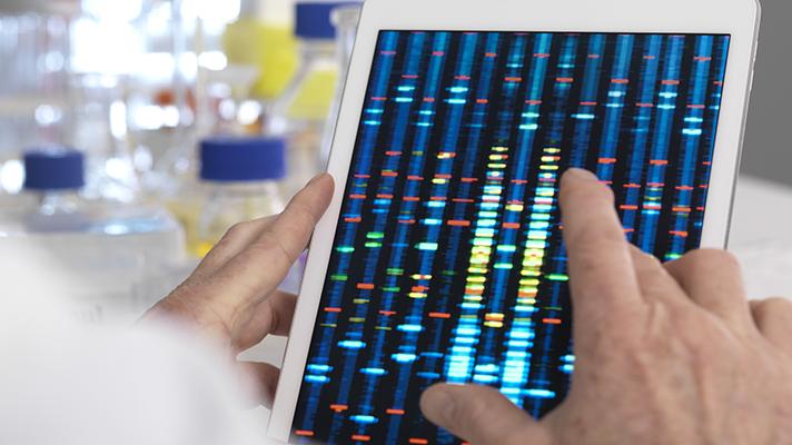 genomics company analyzing dna sample data