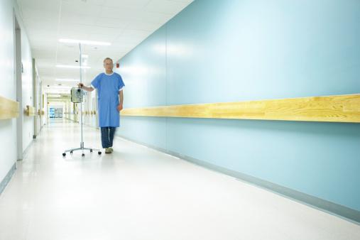Patient in empty hospital hallway