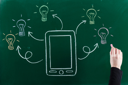 Chalkboard drawing of tablet and lightbulbs