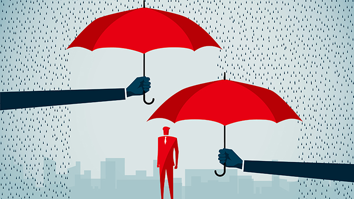 man under two umbrellas