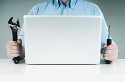 Man at laptop with tools