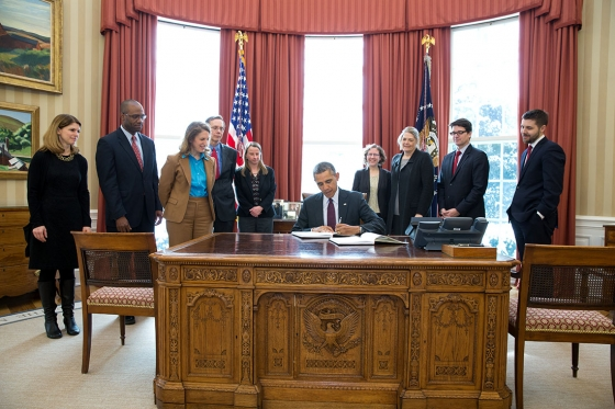 President Barack Obama signs copies of the FY 2015 budget