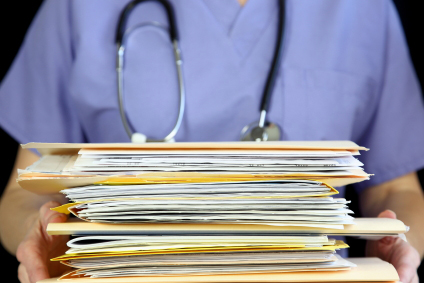 Doctor holding papers