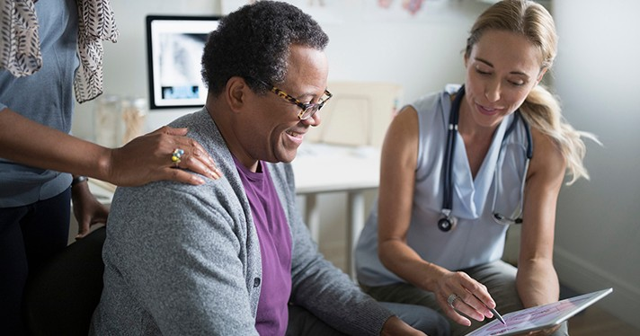 A person with a stethoscope consults with a patient