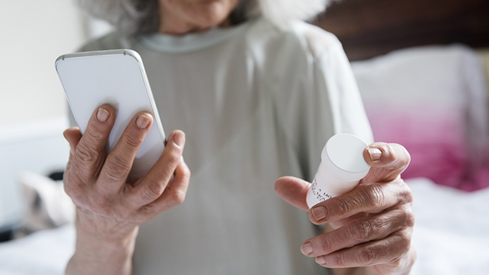Patient using a phone app to manage prescription