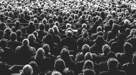 people sitting in a theater, population