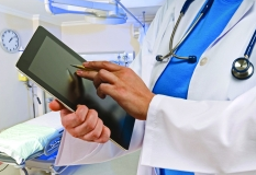 Doctor entering notes on a tablet