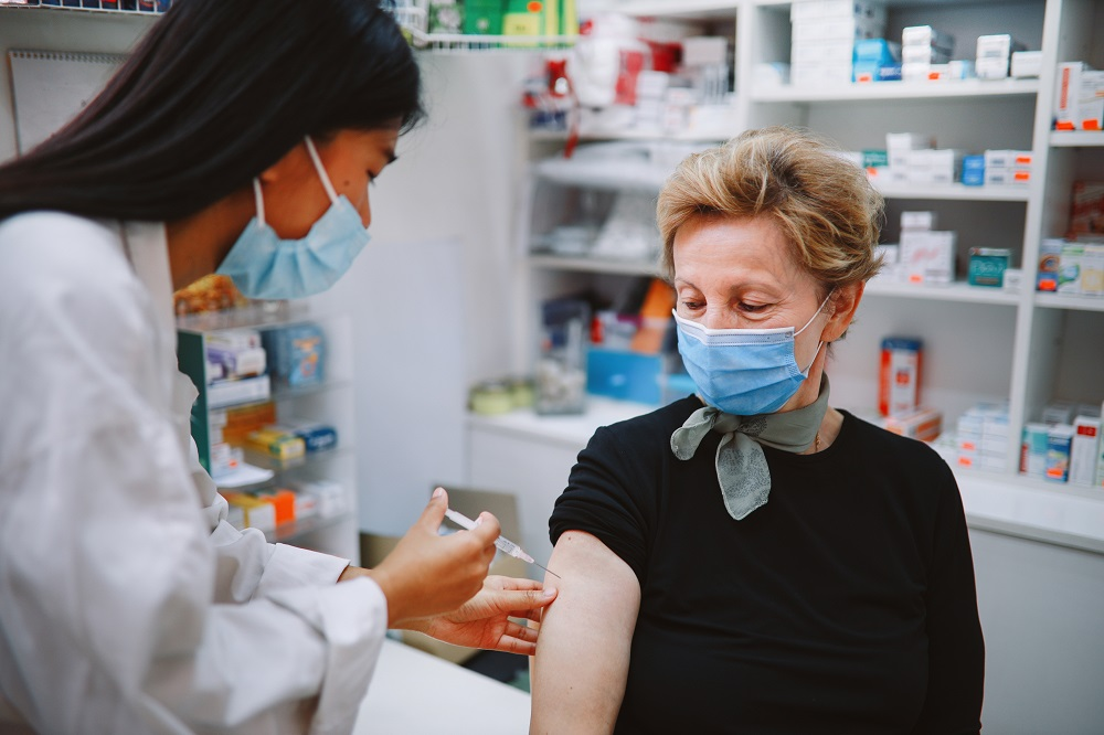 Patient in mask getting vaccinated