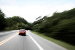 Car speeding down road