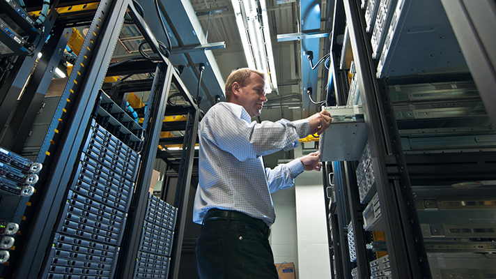 man working on server stacks