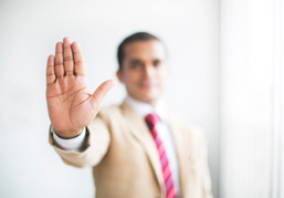 Man holding up hand in stop gesture