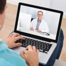 doctor on video call with patient