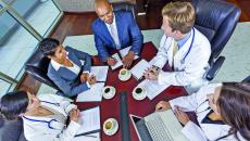Executives and doctors at conference table