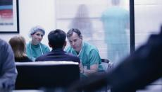 Doctors consulting with patients